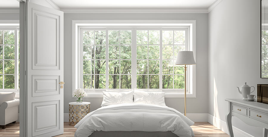 Large windows in a bedroom